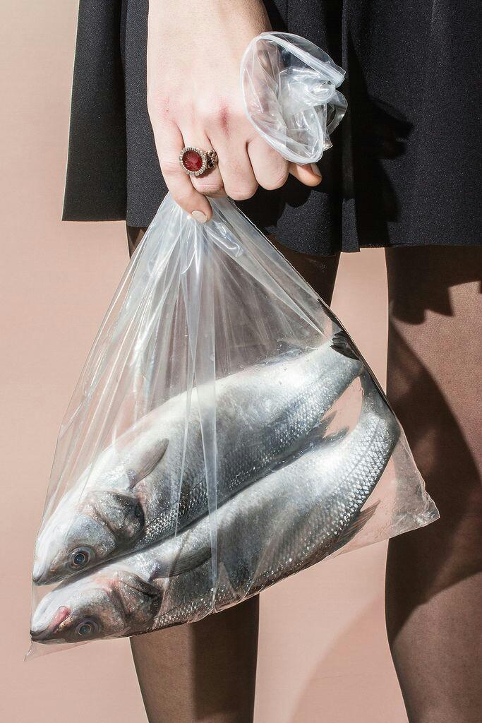 Woman carrying milkfish
