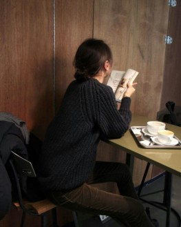 Girl reading and coffee